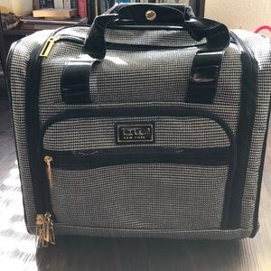 Nicole Miller Rolling makeup case/luggage.
